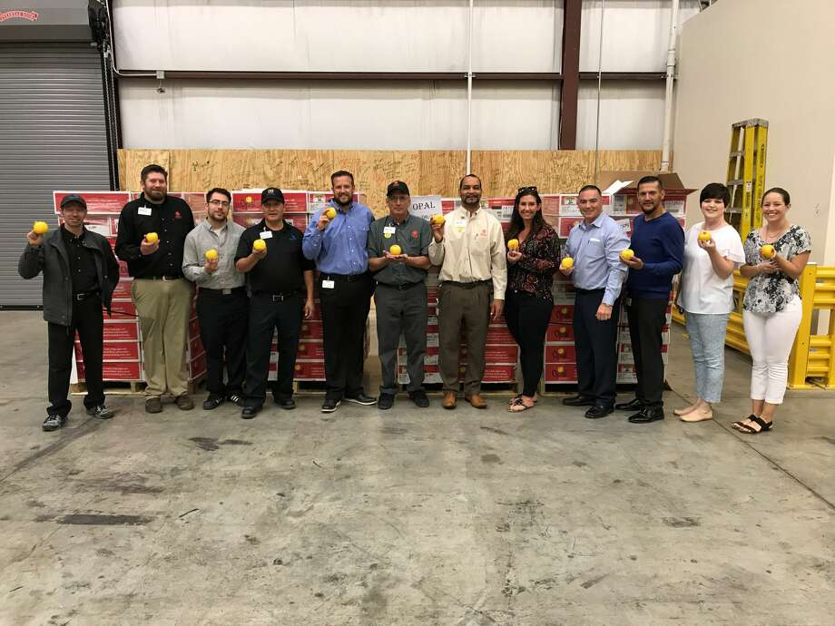 The United Family, which operates Market Street and Albertsons Market in Midland-Odessa, on Thursday presented the West Texas Food Bank in Odessa with 4,860 pounds of apples.  Photo: Courtesy Photo