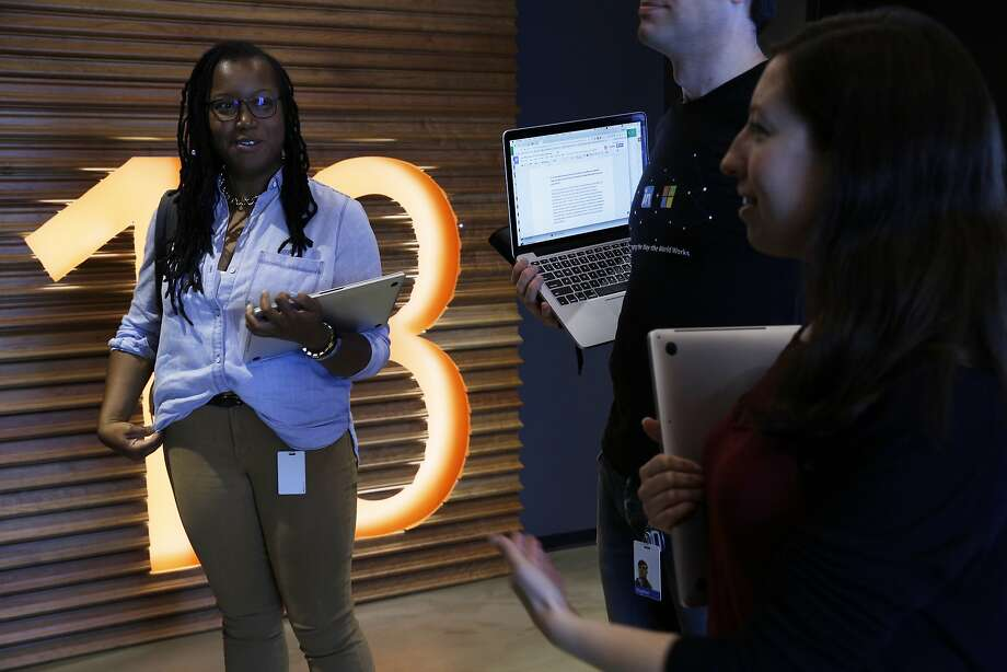 Apprentice software engineers Lyn Muldrow (left) and Katie O'Neill are part of LinkedIn's Reach program, which helps those with nontraditional tech backgrounds. Below: Muldrow works on a laptop. Photo: Santiago Mejia, The Chronicle