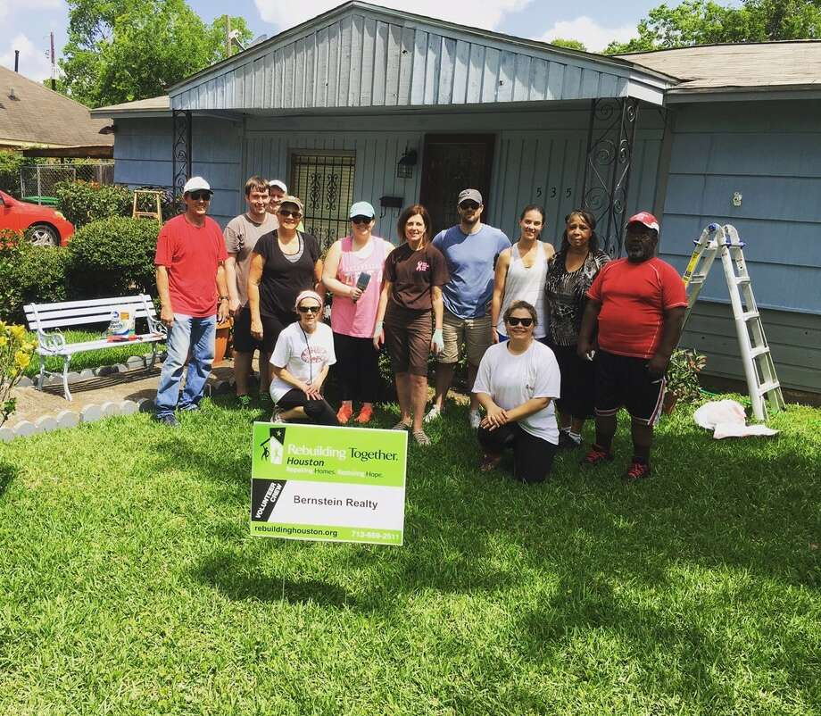 Among the Bernstein Realty team tackling their Rebuilding Together Project where Stan and Suzie Davis, Mark Pesek, Bob Murdock, Clare Byrd, Mary Piper, Andrew and Samantha Bacon and Sarah-Anne Fehr, pictured with homeowners.