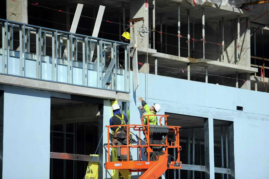 Construction crews work at 100 Commons Park North, on the corner of Washington Boulevard and Atlantic Street, in Stamford, Conn. on Wednesday, Feb. 1, 2017. Photo: Michael Cummo / Hearst Connecticut Media / Stamford Advocate
