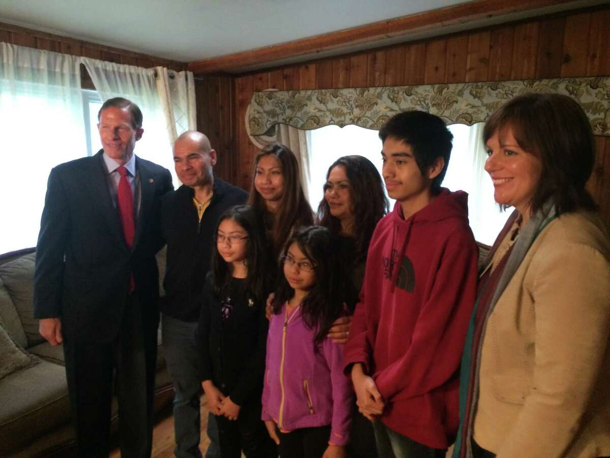 U.S. Sen. Richard Blumenthal poses with Luis Barrios and his family during a meeting Friday in the family's Derby home. The impending deportation of Barrios has captured nationwide interest.