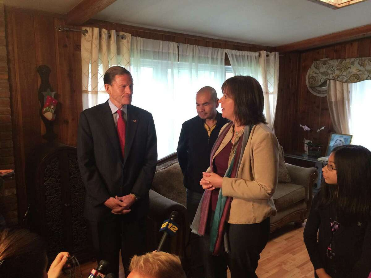 U.S. Sen. Richard Blumenthal discusses immigration proceedings against Luis Barrios with the man's lawyer, Erin O'Neil-Baker during a meeting at the Barrios' home in Derby Friday.