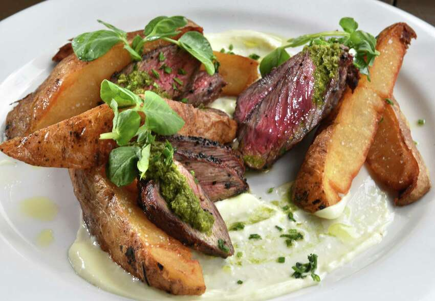 Grilled sirloin with salsa verde and steak fries at Mission Tapas on North Street Tuesday April 25, 2017 in Pittsfield, Mass. (John Carl D'Annibale / Times Union)