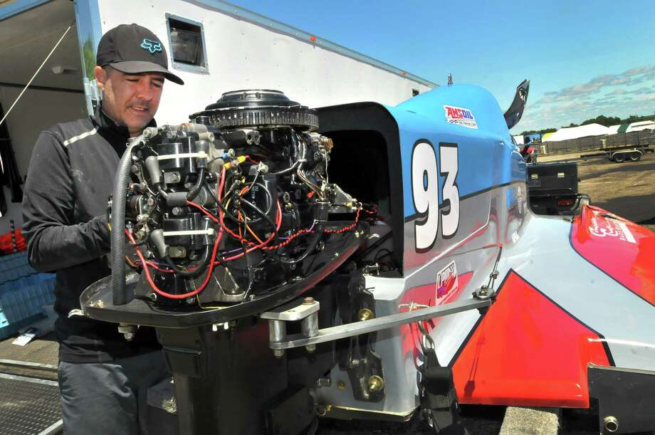 Skelton Racing's R.J. West installs a starter on his SST-45, Formula Light powerboat after arriving in the pit area Thursday ahead of this weekend's Thunder on the Neches races. (Mike Tobias/The Enterprise) Photo: Mike Tobias/The Enterprise