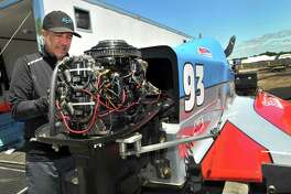 Skelton Racing's R.J. West installs a starter on his SST-45, Formula Light powerboat after arriving in the pit area Thursday ahead of this weekend's Thunder on the Neches races. (Mike Tobias/The Enterprise)