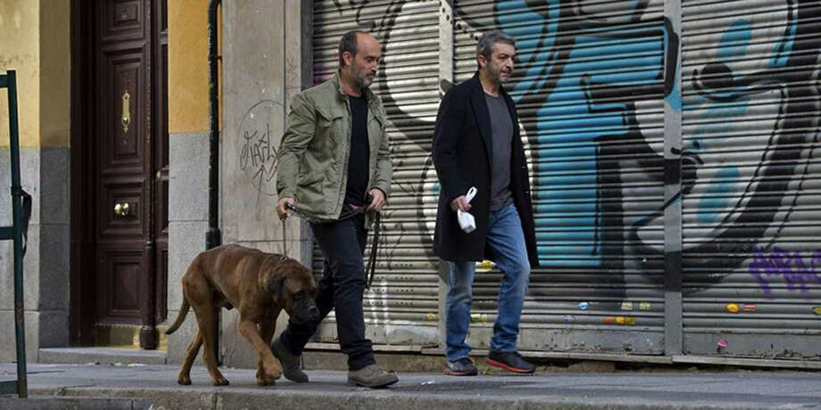 """Javier Camara and Ricardo Darin take the title character for a walk in """"Truman."""" Photo: FilmRise / Los Angeles Times"""