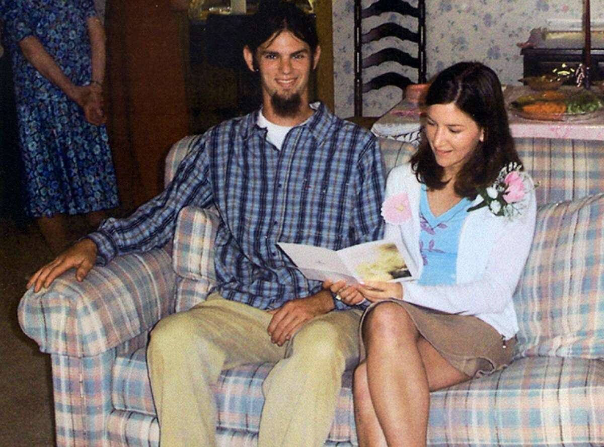 Jason Allen, left, of Michigan, and Lindsay Cutshall, of Ohio, are shown at their wedding shower in May 2004.