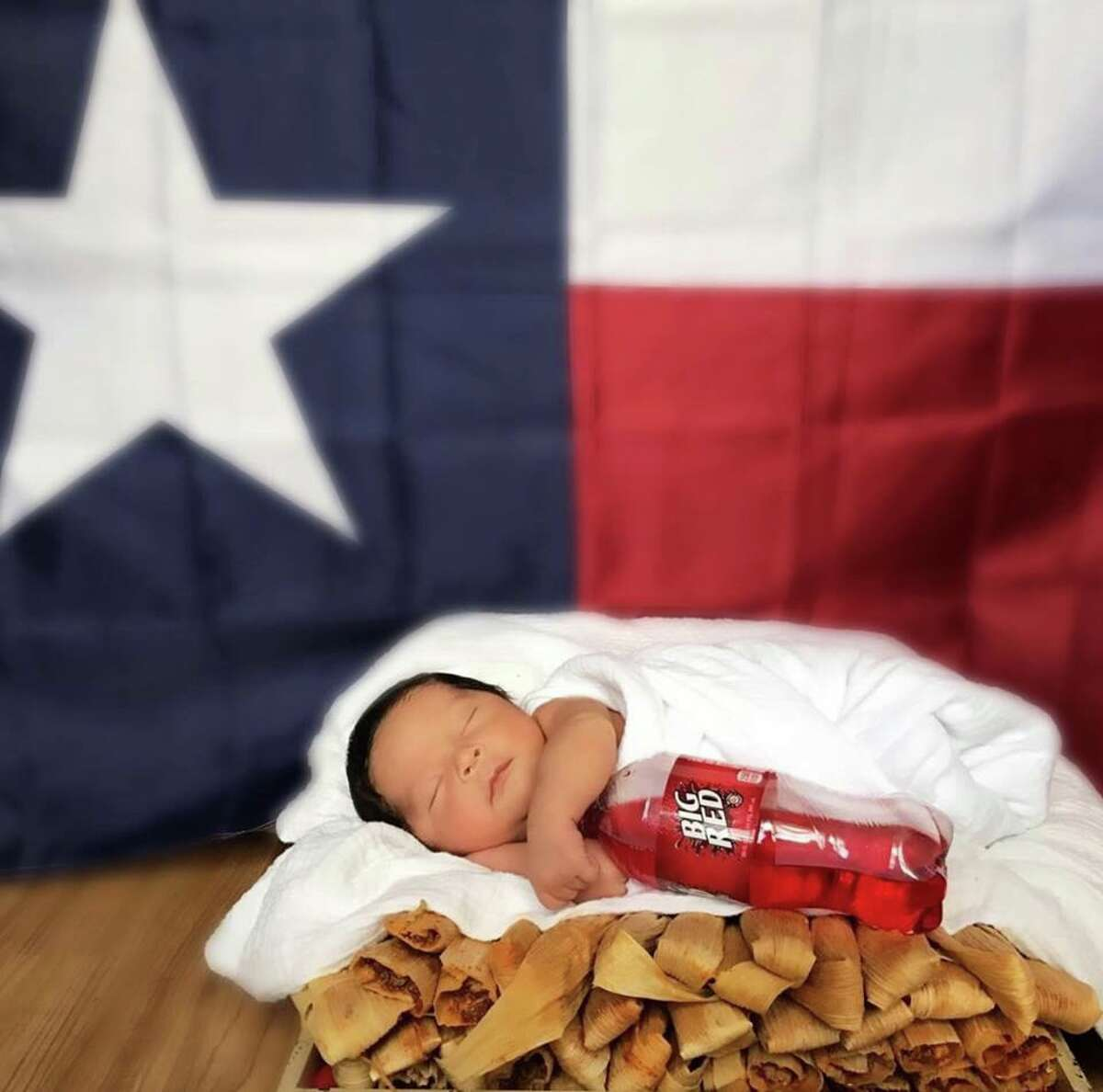 Christina and Javier Sustaita got their son Thomas acclimated with the world and most importantly - the Texas way of life -at the end of March by snapping a viral photo of the little one asleep on a stack of tamales and cuddling a bottle of Big Red.