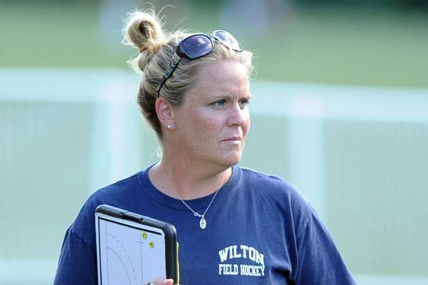 Wilton girls field hockey coach Deirdre Hynes during a scrimmage at Greenwich Academy in 2013.