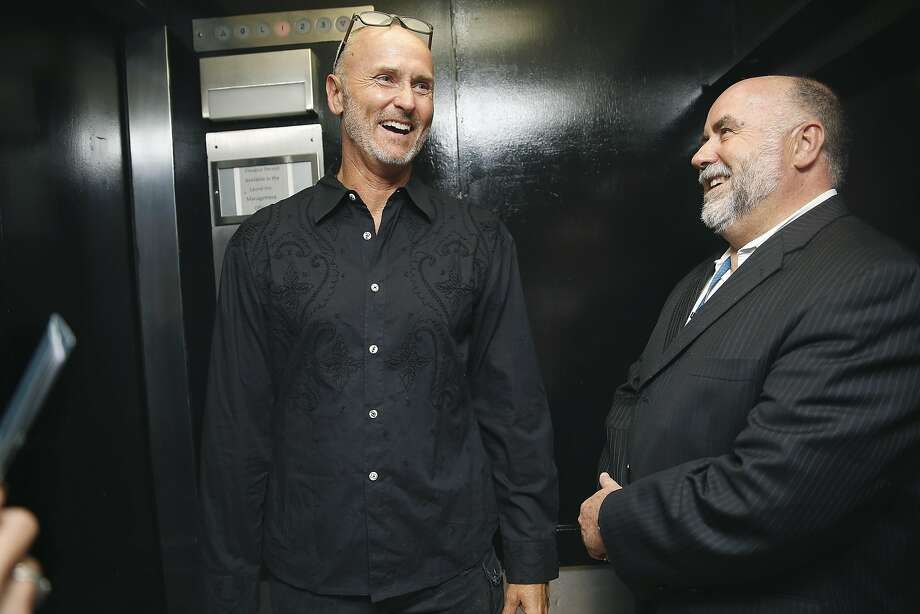 Chip Conley (left), former Airbnb global head of hospitality, is back in the hotel business as he talks with hotel general manager Jeff Durken of the Laurel Inn, which Conley renovated to run as a hybrid vacation rental in San Francisco. Photo: Liz Hafalia, The Chronicle