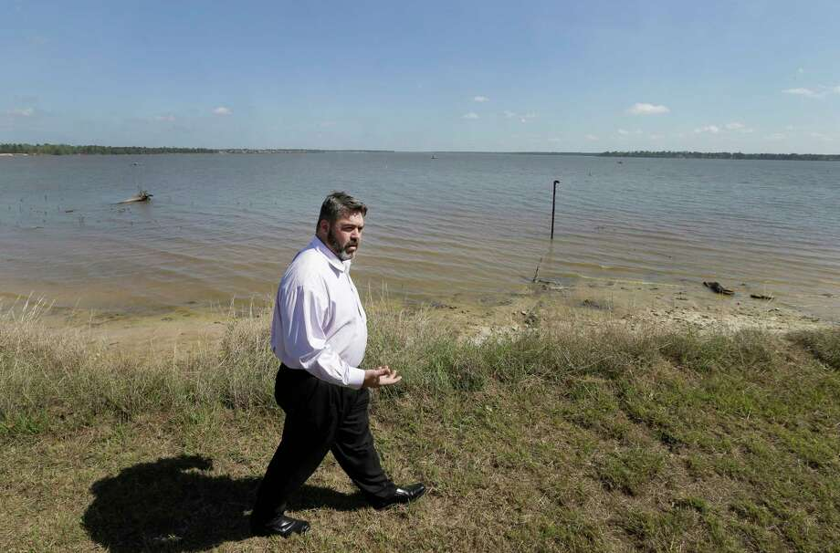 Jeffrey Benjamin, project director, walks along the southwest shore of Lake Houston near where the new intake structure will be built for the Northeast Houston Water Plant expansion. Photo: Melissa Phillip, Staff / © 2017 Houston Chronicle