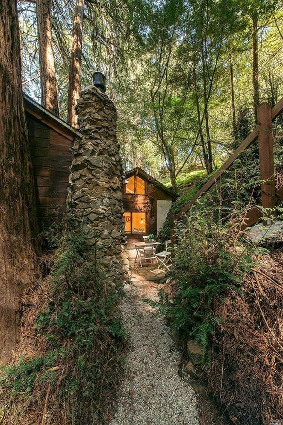 This two-bedroom, one-bathroom tucked away in the woods of Mill Valley at 521 Park Way is accessibly only by footpath. (Open Homes Photography)