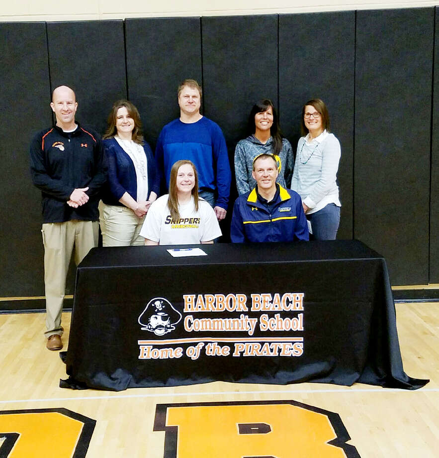 Harbor Beach's McKenna Wolschleger signed her National Letter of Intent to play basketball at St. Clair County Community College next year. In the front row is McKenna Wolschleger and SC4 women's basketball coach Chris Huss (back row from left) is Harbor Beach coach Jim Tamlyn, Connie Wolschleger, Darrin Wolschleger Tanya Huss and Harbor Beach junior varsity girls basketball Ellynne Volmering.