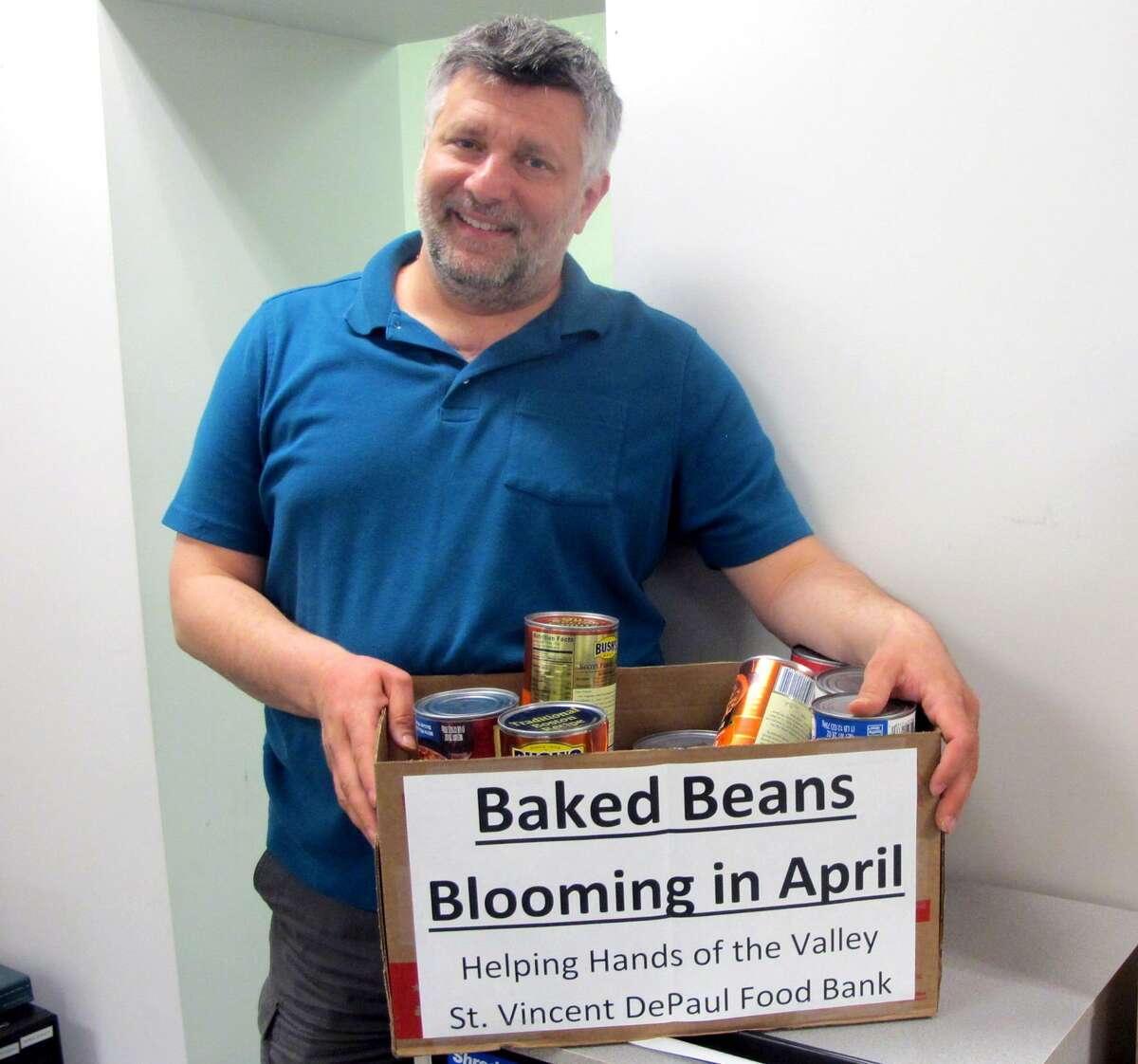 City/Town Clerk Marc Garofalo, a former four-term Derby mayor, was instrumental in creating the monthly City Hall food drive for St. Vincent De Paul's food bank. This month they are collecting cans of clear broth and packages of saltines.