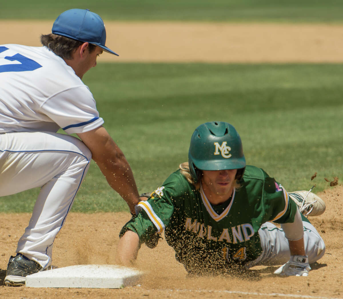 Midland College's Ethan Barker beats the tag on a pick-off attempt as Odessa College's Andrew Morales is late on the tag 5/05/17 in Odessa. Tim Fischer/Reporter-Telegram