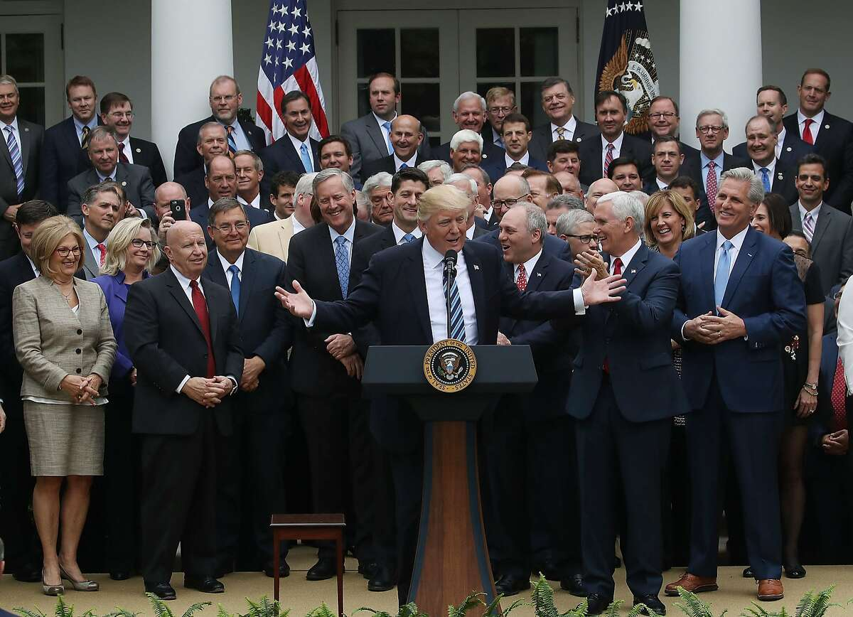 President Trump congratulates House Republicans at the White House after their health care legislation passed on Thursday.