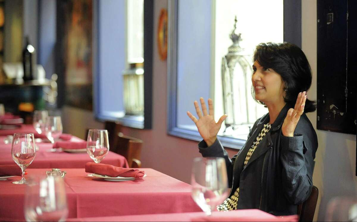 Ramya Subramanian talks about the British Indian influences she and her husband have brought to the Viceroy Publik House restaurant on Summer Street in Stamford on Wednesday, April 26, 2017.