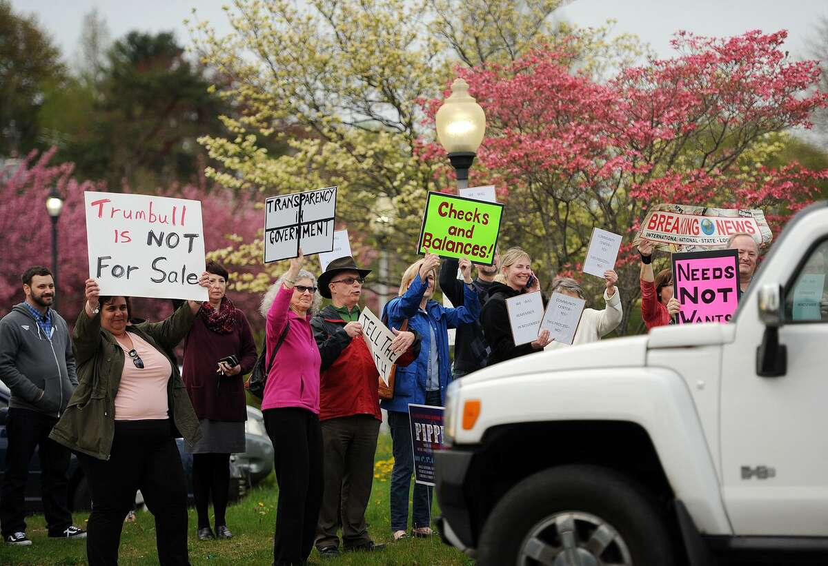 Trumbull residents protest the town's handling of the proposed new Trumbull senior center outside Town Hall in Trumbull, Conn. on Monday, May 1, 2017.