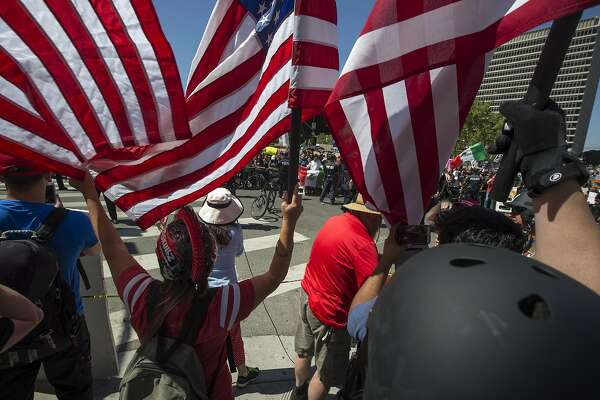 LOS ANGELES, CA - MAY 01: Supporters of President Donald Trump yell at May Day marchers on May 1, 2017 in Los Angeles, California. Numerous May Day rallies and protests triggered by controversies surrounding the President Trump administration are taking place on Los Angeles and others cities across the nation.  (Photo by David McNew/Getty Images)