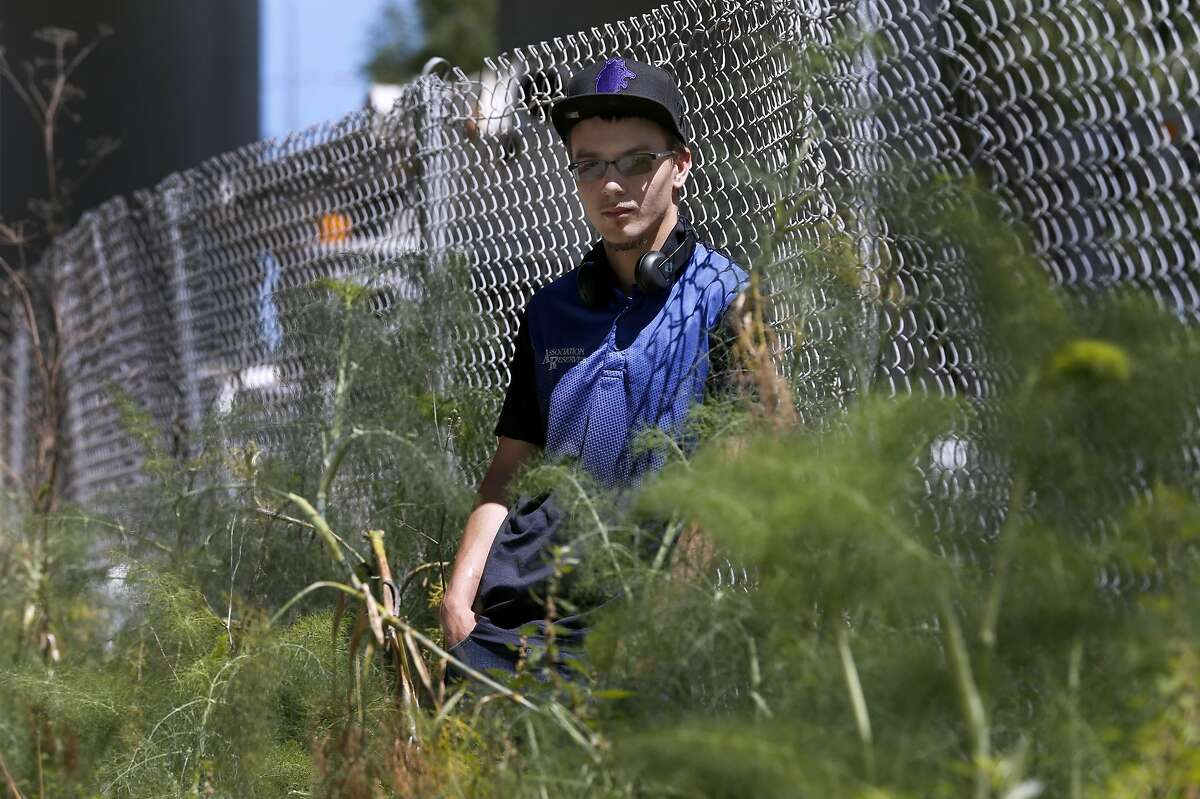 Zak Franet takes a break from his job in a park below Interstate 280 in San Francisco, Calif. on Friday, May 5, 2017. Franet, 23, was homeless for about a year but with assistance from various city programs he landed a job and was able to find housing.