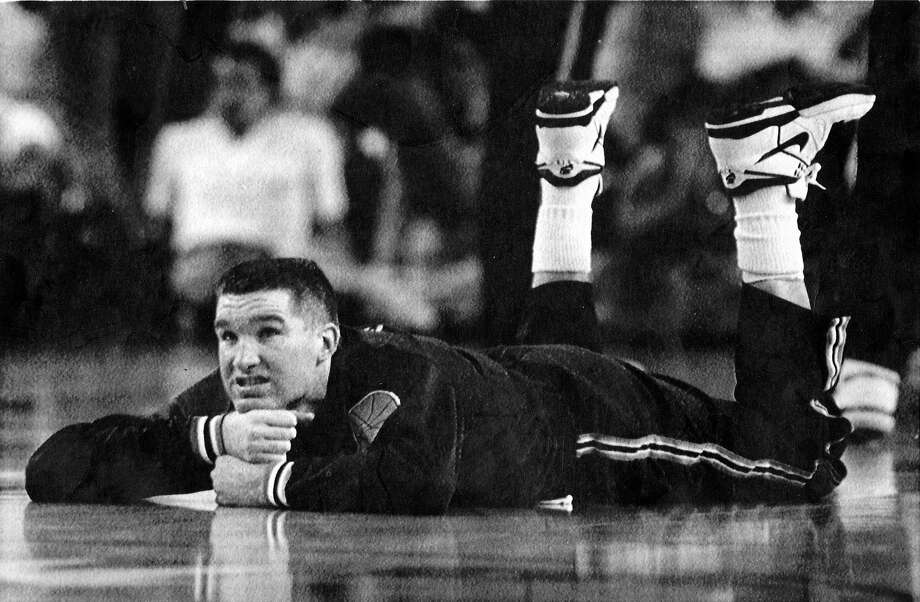 Chris Mullin watches the action during a 1989 playoff game against the Phoenix Suns. Mullin would score 37 points to lead the Warriors to victory in Game 2 of the series.