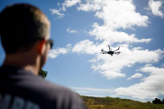 Kevin White of the Menlo Park Fire Protection District deploys a drone during a search and rescue training at SLAC National Accelerator Laboratory in Menlo Park, Calif. Friday, May 5, 2017.
