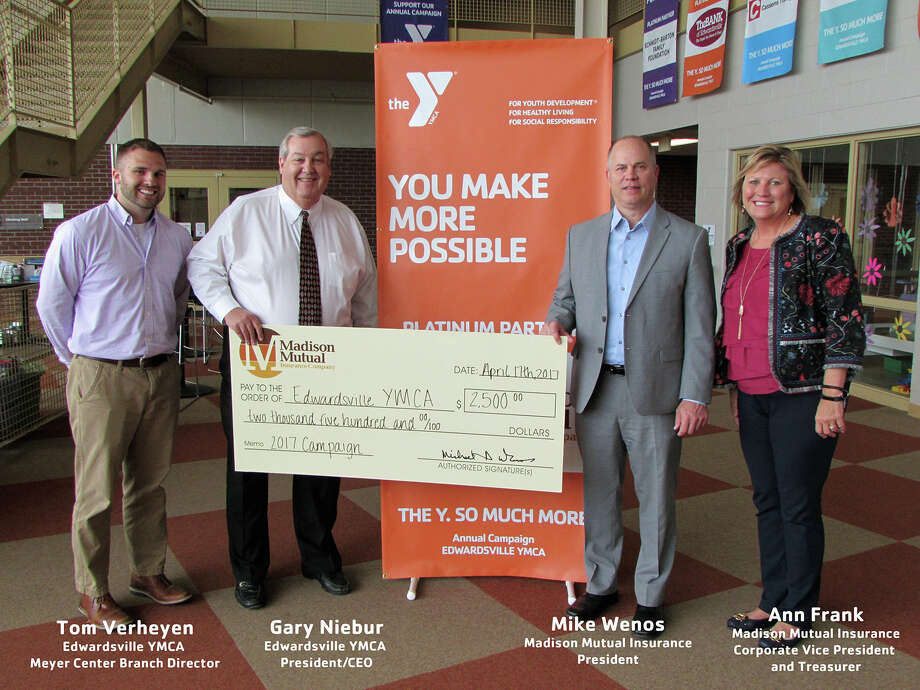 YMCA and Madison Mutual Insurance Company representatives stand with Madison Mutual's $2,500 donation. Photo: For The Intelligencer