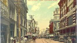 A postcard shows buggies in use in 1890 along Commerce Street in downtown San Antonio.