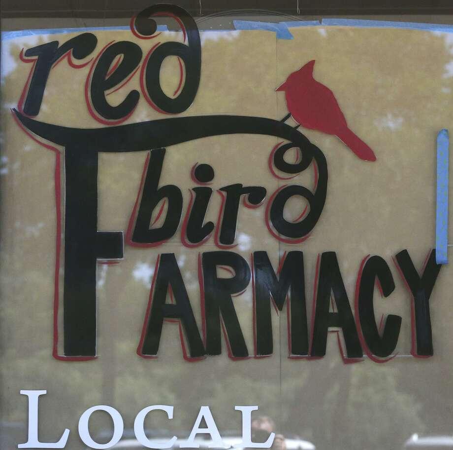 Front window signage at the new Red Bird Farmacy. Photo: John Davenport /San Antonio Express-News / ©San Antonio Express-News/John Davenport