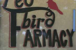 Front window signage at the new Red Bird Farmacy.