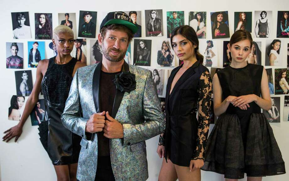Jeff Shell, co-owner of Neal Hamil Modeling agency, far center right, poses for a portrait with Chandilyn Colean, left, Kaylee Ubias and MaryNell Smith, far right, at Neal Hamil Centre on Tuesday, May 2, 2017, in Houston. ( Brett Coomer / Houston Chronicle ) Photo: Brett Coomer, Staff / © 2017 Houston Chronicle