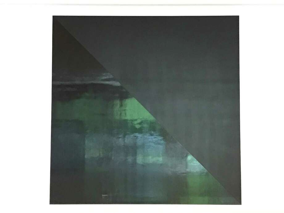 """The glossy section of a painting from """"Glossy and Flat Black Squares"""" has a mirrorlike quality. Photo: Molly Glentzer"""