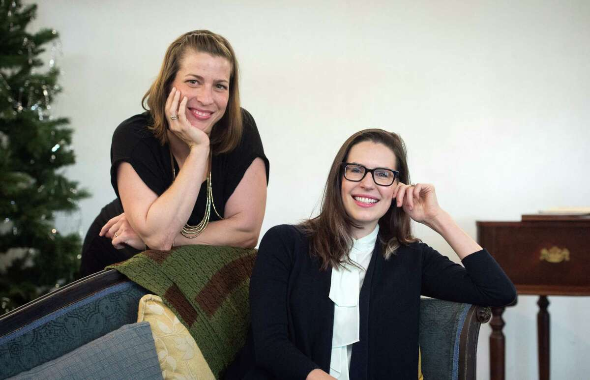 """Playwright Lauren Gunderson (R) and Margot Melcon (L) pose for a photo at the Marin Theatre Company in Mill Valley, California on November 09, 2016. The two wrote a play called """"Miss Bennet: Christmas at Pemberley,"""" to be staged at Houston's Main Street Theater later in 2017."""