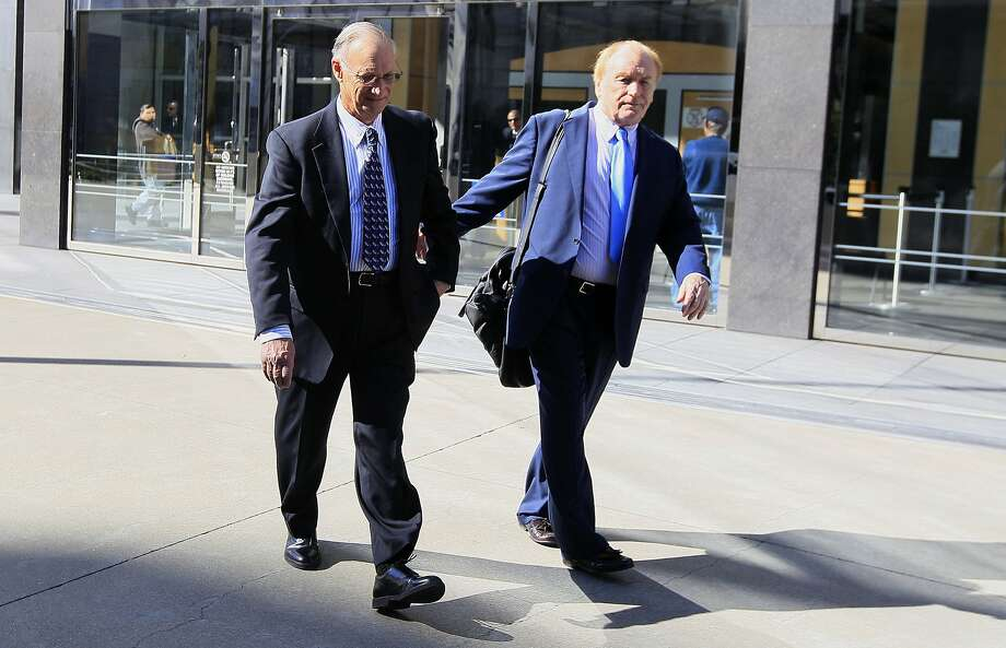 Robert Maegerle, left, walks out of a federal courthouse with attorney Jerome Froelich Jr. in San Francisco in 2012. Maegerle, a retired DuPont engineered accused of working with Walter Liew to illegally sell DuPonts techonology to a company controlled by the Chinese government, pleaded not guilty to economic espionage charges. Photo: Jeff Chiu, Associated Press