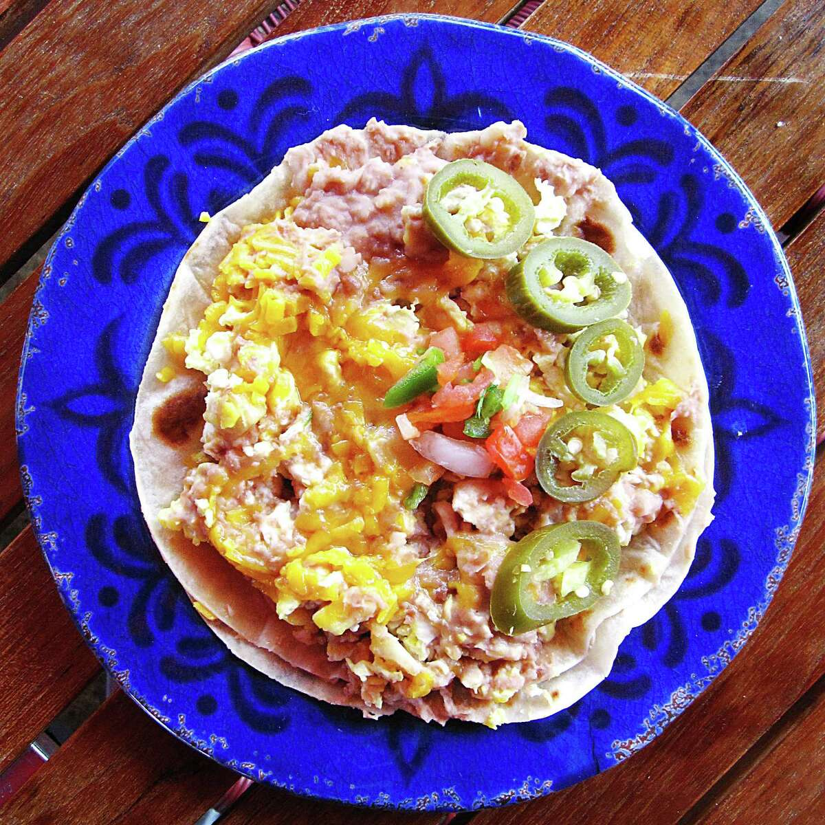 Breakfast pirata taco with eggs, beans, potatoes and cheese on two flour tortillas from Taco Palenque.