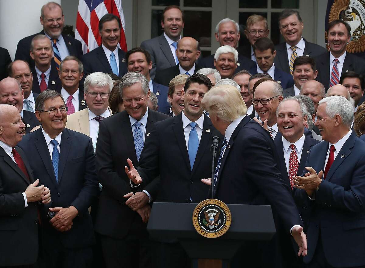 WASHINGTON, DC - MAY 04: U.S. President Donald Trump congratulates House Republicans after they passed legislation aimed at repealing and replacing ObamaCare, during an event in the Rose Garden at the White House, on May 4, 2017 in Washington, DC. The House bill would still need to be passed by the Senate before it could be signed into law. (Photo by Mark Wilson/Getty Images)