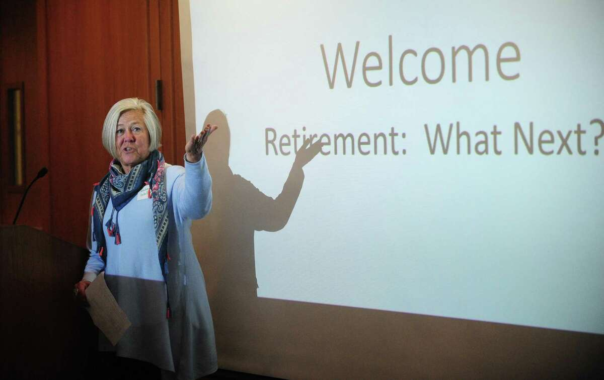 Former teacher Susan Wallerstein emcees Life Beyond the Classroom, a program dedicated to sharing the stories of teachers who have found success in their post-retirement lives helping those who may be nearing retirement on Thursday at Norwalk Community College.