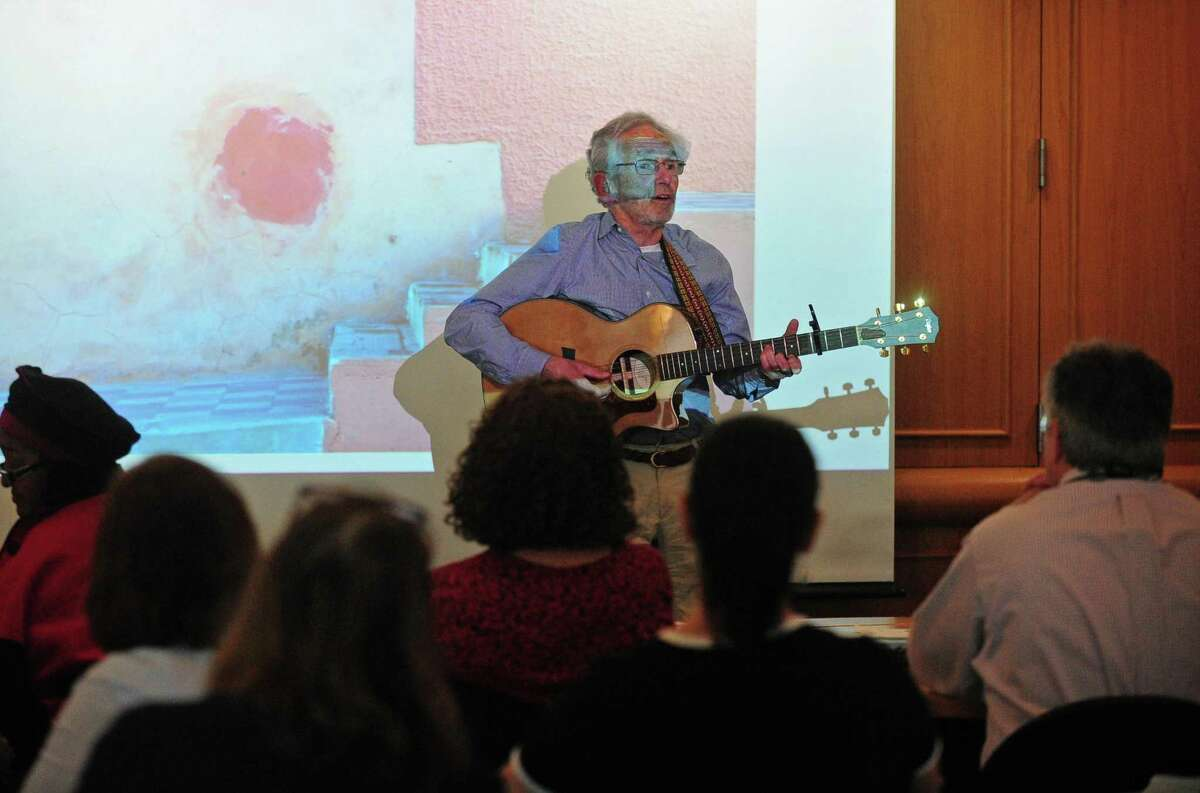 Former teacher Tom Kretch talks about his love of music and photography during Life Beyond the Classroom, a program dedicated to sharing the stories of teachers who have found success in their post-retirement lives helping those who may be nearing retirement on Thursday at Norwalk Community College.