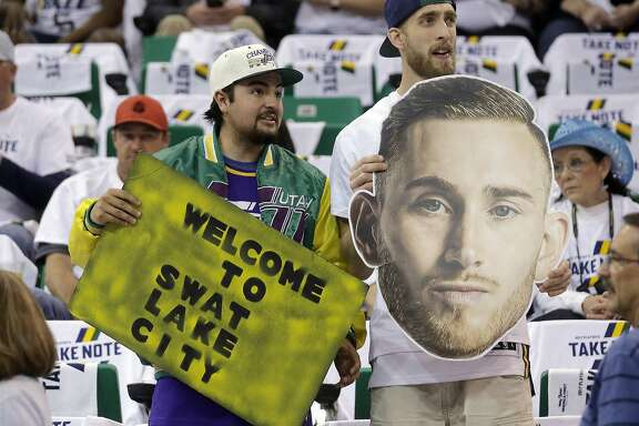 Utah Jazz fans look on before the start of Game 4 of an NBA basketball first-round playoff series against the Los Angeles Clippers Sunday, April 23, 2017, in Salt Lake City. (AP Photo/Rick Bowmer)
