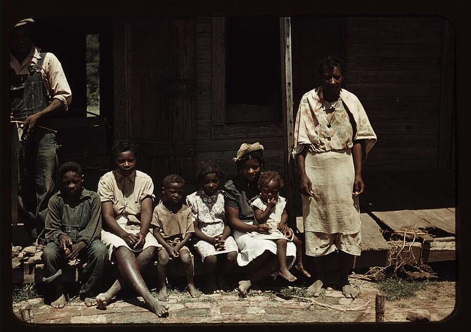 "The Great Depression hit the poorest areas of the U.S. hardest of all, and the American South was no exception. Tenant farmers and migrant workers were already living in extreme poverty and suffering under Jim Crow laws of the region, but during the Depression things became even more starkly dire. These photos were captured by photographers working for the United States Farm Security Administration (FSA) and later the Office of War Information (OWI), mostly in 1939, 1940 and 1941. These are more unusual in the fact that they are presented in full color, while most of the vast number of FSA and OWI images from the same era are in black and white.Note: The original captions have been retained except where they used racially offensive terms. Those terms have either been removed or replaced as necessary.Original caption: ""Bayou Bourbeau plantation, a FSA cooperative, Natchitoches, La. A family (?) seated on the porch of a house, June 1940."" Photo: Courtesy Library Of Congress"