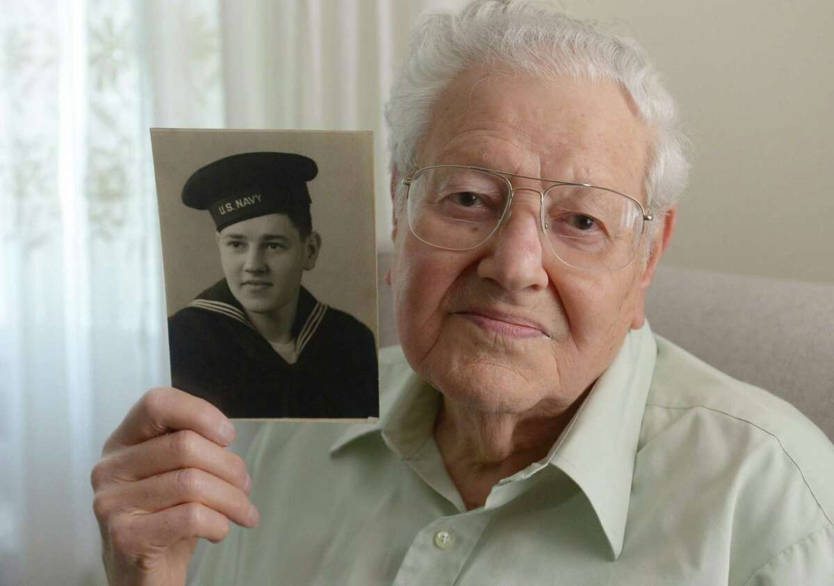 Henry Simon, a U.S. Navy veteran who served aboard a medical ship in the Pacific Ocean during World War II talks about his experiences Thursday, May 4, 2017, at his home in Norwalk, Conn. Simon will serve as grand marshal in the Norwalk Veterans Memorial Committee 2017 Memorial Day Parade.
