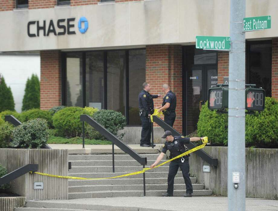 Police respond to a robbery at the Chase Bank in the Riverside section of Greenwich, Conn. Wednesday, April 26, 2017. The same bank was also robbed Tuesday morning with the suspect from that robbery still on the loose. Photo: Tyler Sizemore / Hearst Connecticut Media / Greenwich Time