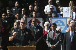 "San Antonio police chief William McManus (at lectern) speaks out against Senate Bill 4 Friday May 5, 2017 in front of the Bexar County courthouse. McManus and other public leaders such as Bexar County sheriff Javier Salazar, Judge Nelson Wolff and Senator Jose Menendez were on hand to voice their disapproval of the bill. The bill would allow police to ask the immigration status of anyone detained and started out as a means to punish so-called ""sanctuary cities.""  ""Senate Bill 4 is bad for public safety,"" McManus said. ""It's a racial profiling bill,"" he said."