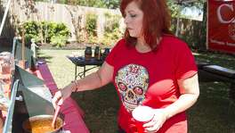 Dianne Edmonson Lewis serves chili at her sister Terry Edmonson Foresman's home.