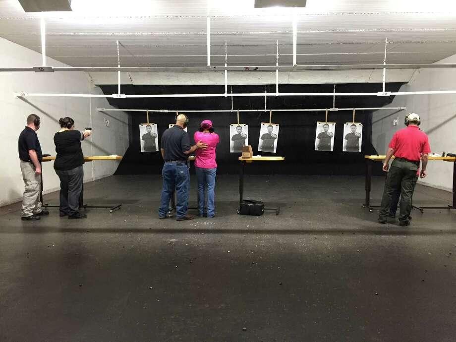Participants in the 29th Citizens Police Academy shoot a variety of guns during a field trip. Photo: Julie Silva