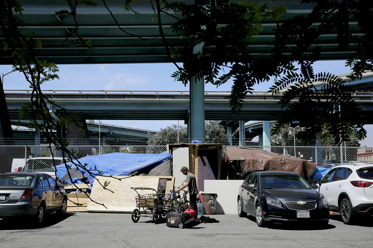 Steven Stackbein, who has been homeless for the past five years, visits a friend's encampment along Vermont St. near 16th st., on Thursday May 4, 2017, in San Francisco, Ca.