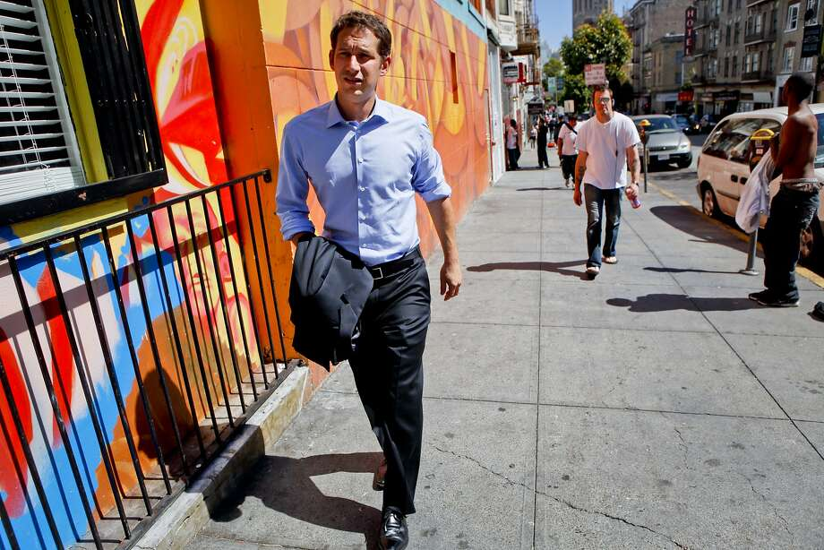 Daniel Lurie walks through the Tenderloin on his way to a meeting at Glide Memorial Church in San Francisco, Calif., on Thursday, July 20, 2011. Lurie, founder of Tipping Point, has raised $30 million since 2005 to help eradicate poverty in the Bay Area. Photo: Russell Yip, The Chronicle