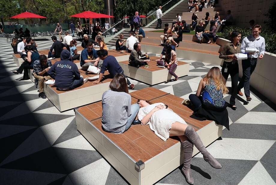 Claire Cassidy relaxes in the outdoor plaza at 525 Market St. Photo: Scott Strazzante, The Chronicle