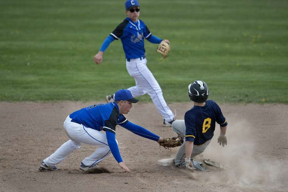 Breckenridge's Garrett Miller slides into second base before Coleman's Carson Cotton can tag him out in the fifth inning of the Friday afternoon game. Breckenridge defeated Coleman 10-4 in the first game. Photo: Brittney Lohmiller/Midland Daily News/Brittney Lohmiller