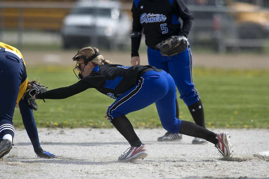 Coleman's Kenzie Miller tags out Breckenridge's Kylie Federspiel as she races back to second base first inning of Breckenridge's home game against Coleman Friday afternoon. Photo: Brittney Lohmiller/Midland Daily News/Brittney Lohmiller